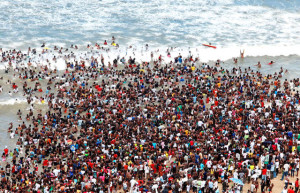 """Close to 100 000 people spend Reconciliation Day at the Durban's Golden Mile beach front in Durban on December 16, 2009.Reconciliation Day was established as a paid public holiday to foster ties across divides, promote unity and strengthen South Africa's democracy. South African President Jacob Zuma said """"Let me emphasise that in this era of promoting renewal, we must promote the values of non-racialism, reconciliation and non-sexism among all our people, black and white"""". During the apartheid, December 16 was known as the Day of the Vow. With the dawn of democracy, the day has retained its status as a public holiday, but with the purpose of strengthening reconciliation and unity amongst all races.The city of Durban is situated on the east coast of the African Continent and attracts thousands of local and international tourists boosting the local economy at this time of the year. The city of Durban is one of the major cities to host the 2010 World Cup soccer tournament in June 2010. AFP PHOTO RAJESH JANTILAL (Photo credit should read RAJESH JANTILAL/AFP/Getty Images)"""
